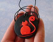Fimo Polymer Clay Medallion - Red Cat over Black