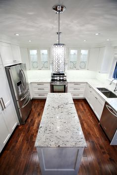 Love the hardwood contrasting with the white in this kitchen renovation by Copper Brook on HomeStars.
