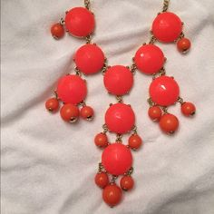 J.Crew Orange Bauble Necklace This beautiful necklace is neon orange. Had several necklaces like this and they go great with almost any outfit! It's never been worn and still has the tags. J. Crew Jewelry Necklaces