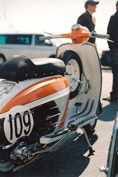 Lambretta in orange and black racing livery Scooters Vespa, Lambretta Scooter, Scooter Motorcycle, Motor Scooters, Yamaha Scooter, Retro Scooter, Scooter Girl, Honda Cub, Sidecar