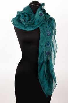 Ruffle Dot Scarf by Deborah Murphy. A celebration of color and texture, this sheer silk scarf is adorned with enchanting felted elements and subtle ripples. 100% silk. Hand wash cold, dry flat. Dimensions: 11''W x 72''L