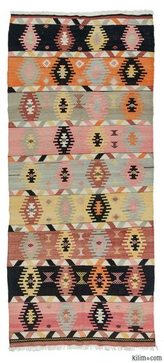 Vintage Turkish kilim rug handwoven in 1960's in Sivas in Central Anatolia. This tribal kilim is in very good condition.