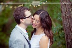 Love this sweet portrait idea of the groom kissing the bride's cheek... candid and natural!