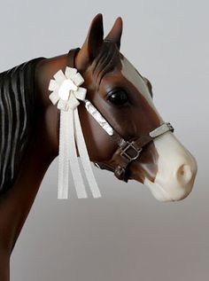 so cute! model sized rosettes! so making for my show!