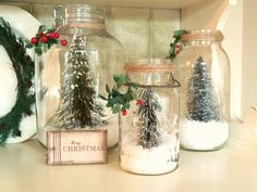 Kate's Place: Christmas Jars...fill jars with fake snow, dollar store trees, twine and greenery decoration on the top...cute for mantle or kitchen