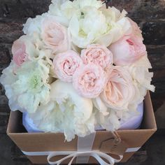 Summer bridal bouquet featuring Bombastic Roses, Peonies, O'Hara Roses and Scabious. www.lucymacnicoll-flowers.com