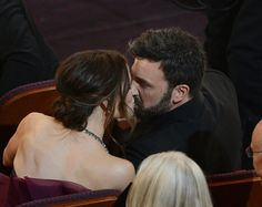The 100 Best Pictures From Oscars Night: Ben Affleck flaunted his best picture statue.   : Jennifer Lawrence showed her excitement after winning best actress.   : Jennifer Garner and Ben Affleck shared a kiss in the Oscars audience.