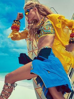 It may be cold here in the Northern hemisphere, but things are certainly heating up for those to the south of the equator. With its November 2015 cover story, Vogue Brazil heads to the beach with cover girl Caroline Trentini. Posing for JR Duran, the blonde beauty wears colorful fashions including swimsuits, jackets and sunglasses …