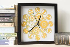 Yellow clock with a cog design that looks great in any home. Available at https://www.etsy.com/uk/listing/278683470/cogs-clock-square-clock-yellow-wall