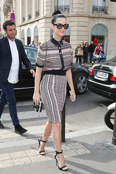 Katy Perry makes an entrance onto the best dressed list this week in a chic Fausto Puglisi Resort 2014 top and skirt. The singer topped off the look with the infamous Chanel 'Lego' clutch, reflective sunglasses and black sandals.