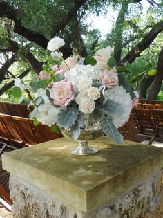 Ivory and blush roses, white hydrangea and dusty miller.