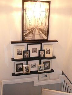 Use picture rails as a way of displaying a collections of small images or photos to get the effect of a gallery wall without committing to one composition or lots of nail holes. You can easily rotate images by swapping out the frames only.