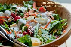 Easy Green Salad with Garlic Dill Dressing. A nice, light salad for those hot summer days. ohsweetbasil.com