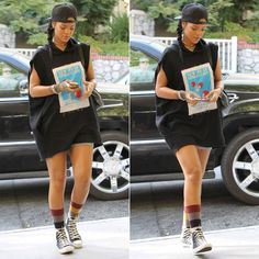 Rihanna wearing Givenchy black baseball cap, Martine Rose Fall 2014 black sleeveless hoodie