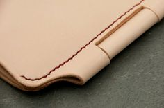 Custom Leather Cover No. 120 for Field by TheRailroadLeatherCo - seems to use a pen to hold the cover closed.