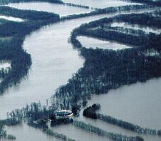The Jonquière power station dam, along Rivière aux Sables in Québec, was overtopped during a flood in 1996, causing damage to the valley and the dam. — Reproduced with the permission of Natural Resources Canada 2011, courtesy of the Geological Survey of Canada (1997-42L by G.R. Brooks).