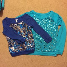 Girls size 14 justice sweatshirt and sequined top Two shirts from justice both size 14. First one is a fitted style shirt with three-quarter length sleeves. Sequins on front change from silver to blue depending on which way they are turned as shown by my hand in the last picture. Second shirt is more of a loose fitted turquoise shirt with foiled cheetah print.   This shirt was worn one time Justice Tops