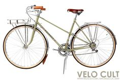 Peugeot Mixte as a Randonneur. Fenders, racks, lights, sturdy tires, and a comfy seat are key.