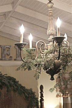 A very French Christmas idea -    Hmmm  -  I have a chandelier -  I have a mercury bead garland - now all I need are some fresh cedar greens & voila -  I  will also have a very French Christmas chandelier  !