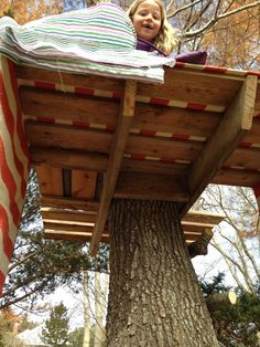 Girl Above Peering Over Edge of DIY Treehouse Deck