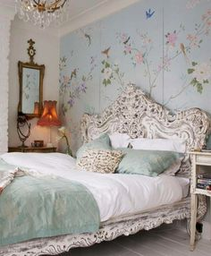 Baroque bed and floral wallpaper. Dreamy