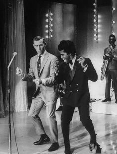 Johnny Carson and James Brown bust a move