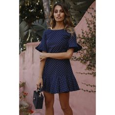 Navy dress. Lined. Cold hand wash only. Model is a standard XS and is wearing XS. True to size. Non stretchy fabric. Invisible back zip. Print placement may vary. Cotton. We've got a major soft spot for our Unsung Hero Dress. This style has a round neckline, short sleeves that flare at the cuff and an invisible back zip that's secured by a metal clasp. It also has a sweet frill hem for added flirty flair. We love wearing ours with black booties and a faux fur coat!