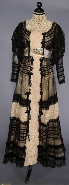 MAISON ROUFF TEA GOWN, PARIS, c. 1910 Unlabeled w/ museum attribution, black point d'esprit net over embroidered net dress, narrow black velvet trim & bows, watered silk W sash,