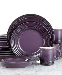 Le Crueset Dinnerware, Amazing colors to choose from. You'll be inviting guest over just to show this off! Come check it out at Wild Goose in Perham,MN Casual Dinnerware, Dinnerware Sets, Purple Dinnerware, Purple Home, Turquoise And Purple, Purple Kitchen Decor, Lavender Kitchen, Whimsical Kitchen, Gris Violet