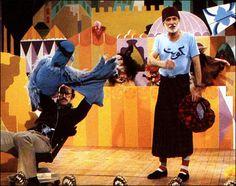 """Behind the scenes of the Muppet show episode Spike Milligan, Frank Oz performing Sam Eagle on an office chair during """"Its a small world"""" song."""