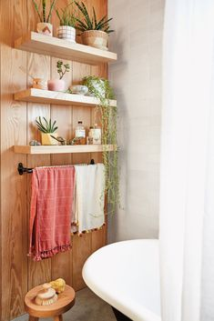 Mau's Home Tour is Quintessential Canyon Cool Exposed wood shelving in the bathroom. Love all the plants on the wall!Exposed wood shelving in the bathroom. Love all the plants on the wall! Bathroom Plants, Small Bathroom, Wood In Bathroom, Wood Bathroom Shelves, Feminine Bathroom, Tropical Bathroom, Bathroom Bin, Master Bathrooms, Downstairs Bathroom