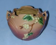 """Description: A most beautiful and interesting hanging basket also known as """"Rose Bowl"""" made by the Roseville Pottery Company. The Vase is in the pink Snowberry pattern. Date: 1947. Marks: """"Roseville,"""