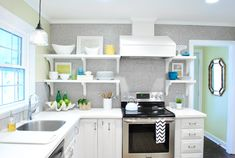 What a stinking fun kitchen update. LOVE the cleanliness of the white. It doesn't look too overdone either. Young House Love, they have an incredible eye for perfect editing. @Sherry @ Young House Love