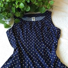 Rockabilly dress EUC Rockabilly inspired dress. Beautiful navy color with tan polka dots. Raised pleats or sewing for added texture and design. Belt loops on waist if belt is desired. No rips stains or tears. From smoke free, pet free home. Size: Petite large. Fits size 8-10 Dresses