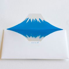 Surprise your friends with a special letter or invitation using this wonderful Mount Fuji envelope. It first appears like a normal envelope outside but the inside reveals Mount Fuji with its snow can and a reflection in one of the many surrounding lakes Japan Design, Envelope Art, Envelope Design, Fuji Mountain, Monte Fuji, Illustration, Shape Design, Design Model, Kirigami