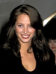 Christy Turlington is one of most iconic supermodels ever. Here, we take a look back at the supermodel's most memorable beauty moments of the last 15 years. Pulled Back Hairstyles, 90s Hairstyles, Straight Hairstyles, Tatjana Patitz, Niki Taylor, Stephanie Seymour, Long Brunette, Brunette Woman, Christy Turlington