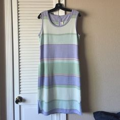 St. John knit dress Beautiful pastel striped dress with small slits at the sides. Brand new. Very small blemish near the right underarm St. John Dresses