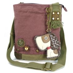"Chala Patch Crossbody, Washed Canvas Handbag, Zipper Top , Animal Prints (Toffy Dog - Mauve). Handle drop: 13"" to 26"". Body of bag: 10"" L x 10.5"" H x 4"" W. Washed canvas with brass-tone hardware. Single adjustable carrying handle. Zip top closure. Detachable coin purse. Fully lined compartment. Interior zip and slip pockets."