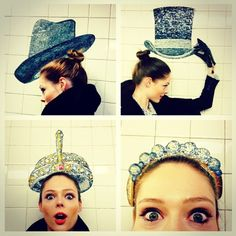 Playing with hats in the subway.