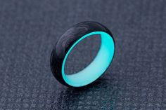 Carbon Lume Ring - Turquoise Glow in the dark carbon fiber rings...