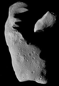 Asteroids Ida and Gaspra. THE IMPACT OF ASTEROIDS: Ida (left) and Gaspra (right) are just two of the billions of such rocky and metallic objects that orbit the Sun mainly between Mars and Jupiter. Shown here to the same scale, Ida is about 30km long (19 miles), and Gaspra is about 17km (11 miles). Asteroids have played a role in the evolution of life on Earth. Sometimes the orbits of asteroids bring them close to Earth and collisions ensue. Not only do scientists think some of Earth's water…