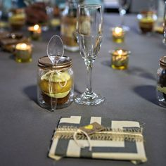 The couple got crafty for their favors and thanked guests with adorable DIY cupcakes in mason jars complete with a spoon, along with a perso...