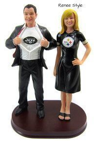Superman Sports Groom and Sporty Bride Wedding Cake Topper is custom sculpted to look like the bride and groom.  You select the team, numbers and names.  This one shows the New York Jets and Pittsburgh Steelers.