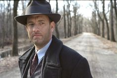 tom is a gangster in Road to Perdition