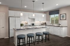 A large kitchen like this is a must for any serious chef or busy parent looking to keep little tummies fed. There's plenty of room at the island for after-school snacking or after-dinner card games.