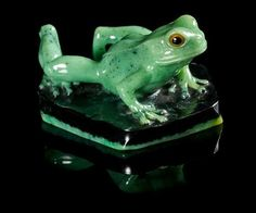 A Zoisite Frog Carving, Gerd Dreher,, Idar-Oberstein, Germany,, formed from a single piece of layered zoisite and black hornblen - Price Estimate: $1000 - $2000