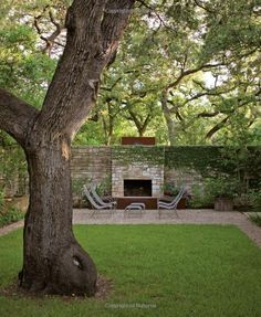 outside fireplace against wall contemporary outdoor fireplace, courtyard garden, stone wall, clean landscape