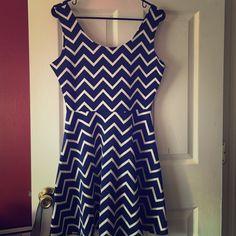 Dark blue and white chevron dress!  96% polyester blue and white chevron dress! Minimal wear, and in great shape! Dresses Midi