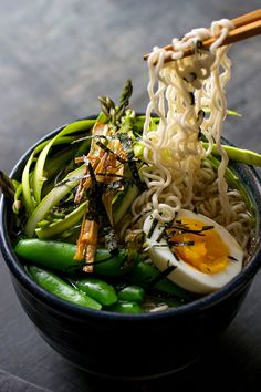 This lighter take on ramen, with snap peas and shaved asparagus, comes from the vegetarian cookbook author Lukas Volger The flavors are perked up with pounded or grated ginger and lemon zest You can skip the frizzled scallion garnish, but it does add nice texture to the finished bowl. (Andrew Scrivani for The New York Times)