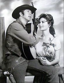 Clu Gulager as Billy the Kid with Marianna Hill as his sweetheart, Rita from the television program The Tall Man.